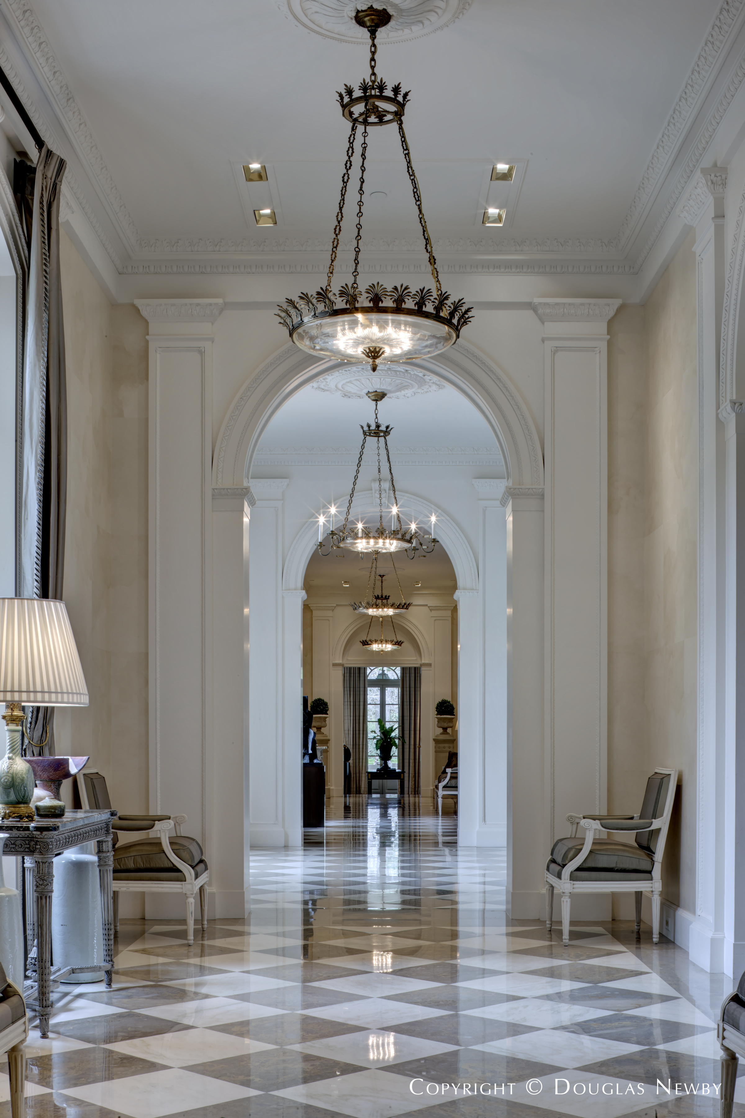 View of a Hallway in the Crespi Hicks Estate Home Showcasing Beautiful Chandeliers