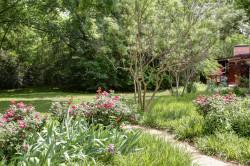 Path Through Flowering Garden to Extensive Lawn