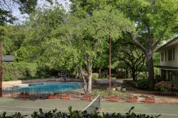 Tennis Court and Swimming Pool of Period Modern Home From 1963