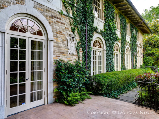 Elegant Archways and French Doors Open to Grounds